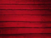 日志红色墙壁 免版税库存照片