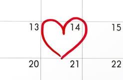 日期在日历,被包围的情人节红色重点的2月14日 库存照片