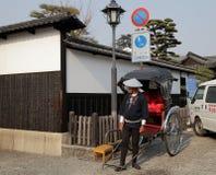 日本传统人力车制帽工人 免版税库存图片