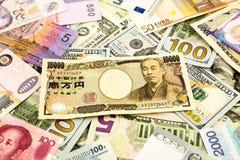 日本和世界货币金钱钞票 免版税库存图片