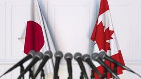 日本和加拿大的旗子在国际会议或交涉新闻招待会 影视素材