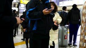 日本地铁驻地的通勤者 股票录像