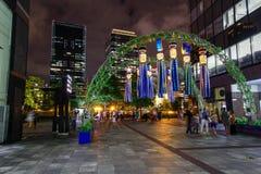 日本大阪 寺庙在大阪在春天,开花的季节,樱花 星节日的装饰,称'Tanabata'在梅田 免版税库存图片
