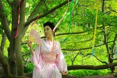 日本少妇在春天森林里 图库摄影