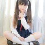 日本式逗人喜爱的学校女孩室内家庭性感的妇女 免版税库存照片