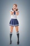 日本式水手服的学校女孩 免版税图库摄影
