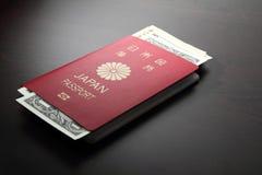 日本护照和美元 免版税库存照片