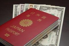 日本护照和美元 免版税图库摄影