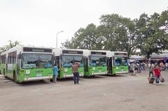 日本政府捐赠的老挝人绿色城市公共汽车在万象早晨旁边位于的中央汽车站销售公共汽车总站 免版税图库摄影