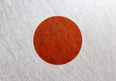 日本旗子,葡萄酒,减速火箭,被抓的,钢背景 免版税库存照片