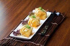日本烹调 在背景的油煎的豆腐 免版税库存图片