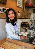 日本甜店主 库存照片