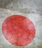 日本的旗子的图象反对老墙壁背景的 免版税库存图片