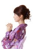 日本祈祷的妇女 图库摄影