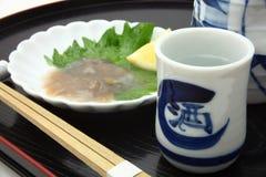 日本米酒`缘故`和盐味的海参胆量 图库摄影