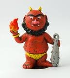 日本红色邪魔小雕象 库存照片