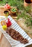 日本食物wafu牛排在白色板材服务用酱油, w 免版税图库摄影