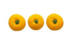 从日本黏土的三个桔子模型 库存图片