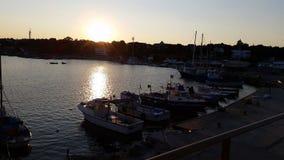 日落和小船在阿赫托波尔 库存照片