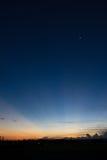 日落在有蓝天的城市 免版税库存图片