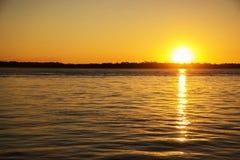 日落在河 免版税图库摄影
