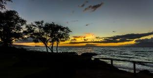 日落在看Molokini (夏威夷)的毛伊 库存图片