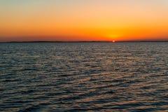 日落在离基拉戈的附近海岸  库存照片