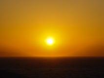日落在米科诺斯岛cyclides海岛在希腊 库存照片