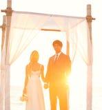 日落婚礼 库存图片