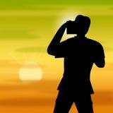 日落摄影师显示温暖的Pic和日落 免版税库存照片