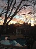 日落橙色天空场面在冬天 免版税库存图片
