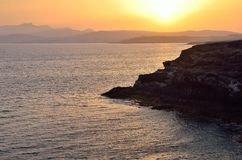 日落海洋海滩岩石 免版税库存照片