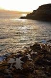 日落海洋海滩岩石 图库摄影