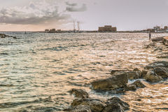 日落的帕福斯港口 库存照片