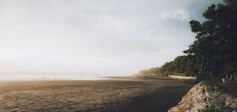 日落的海滨全景在巴厘岛 免版税图库摄影