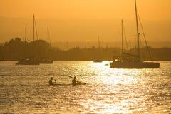 日落的皮艇 图库摄影