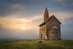 日落的老罗马教会在Drazovce,斯洛伐克 免版税图库摄影