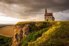 日落的老罗马教会在Drazovce,斯洛伐克 免版税库存照片