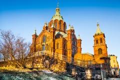 日落的著名Uspenski大教堂在赫尔辛基,芬兰 库存照片