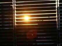 日落通过Windows 免版税库存照片