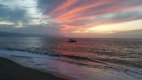 日落,巴亚尔塔港墨西哥 免版税图库摄影