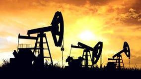 日6月卡扎克斯坦月西部的油泵 库存照片