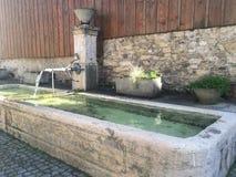 旧世界瑞士人喷泉 库存图片
