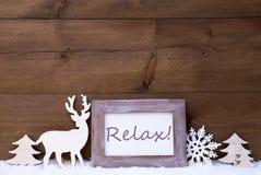 破旧的别致的圣诞卡与放松 免版税库存图片