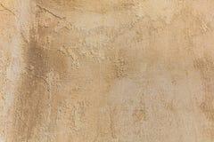 破旧的淡黄的墙壁背景 免版税库存图片