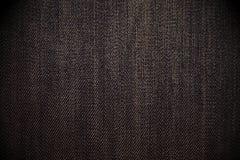 破旧的黑斜纹布背景 库存照片