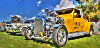 旧车改装的高速马力汽车黄色 免版税库存照片