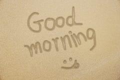 早晨好与微笑的面孔的手文字在samd 库存图片