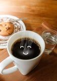 早晨好微笑咖啡用曲奇饼和水 免版税库存图片