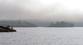 早晨薄雾的海岛 库存照片